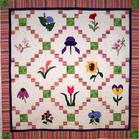 tulips sunflower iris flowers quilt free hand feathers