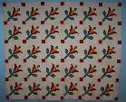 hand pieced tulip applique custom quilting feathers