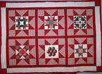 red green christmas quilt cutom quilting feathers