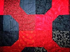 bowtie red black feathers quilt