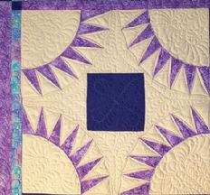 feathered scrolls and continuous curve machine quilting