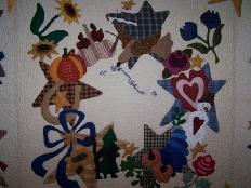 hand appliqued outline quilting feathers
